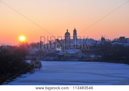 Winter dawn. Panorama of the river Ros and the church of Saint Mary Magdalene.
