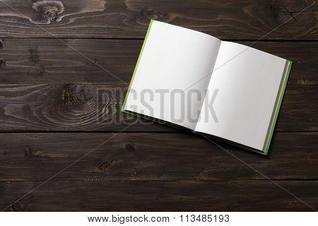 Notebook  On A Dark Wooden Background