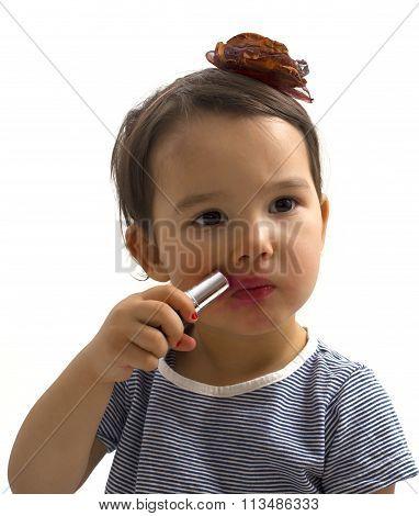 Fashion Little Girl Applying Lipstick