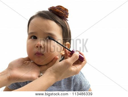 Mother Applying Makeup To Her Little Girl