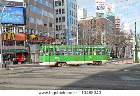 SAPPORO, JAPAN - December 22, 2015: Street view of Tram station during winter in Sapporo, Hokkaido, Japan.