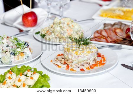 Cutting Sausages And Salads On A Banquet Table