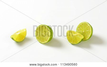 Fresh lime fruit halves and wedges