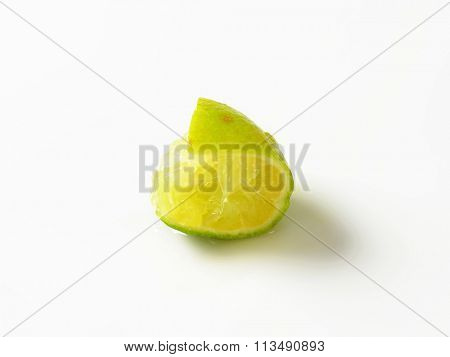 squeezed slice of lime on white background
