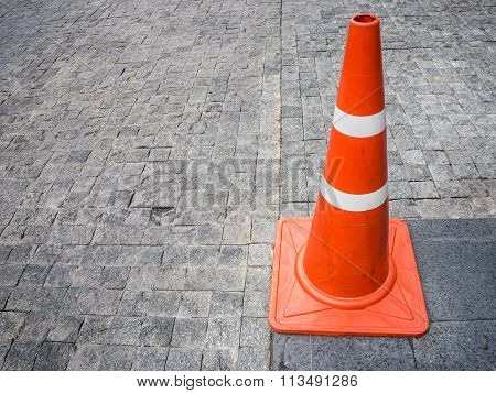 Traffic Cone on the brick floor