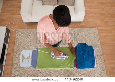 Woman Ironing Clothes On Iron Board