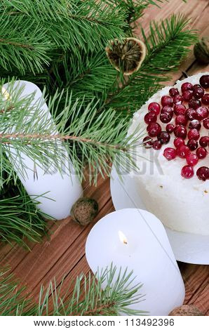 Holiday Layered Cake With Cream And Cranberry Decoration