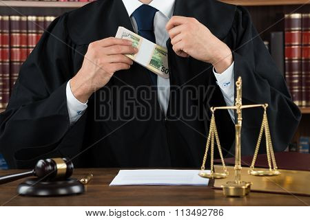 Corrupt Judge Putting Dollar Bundle In Pocket