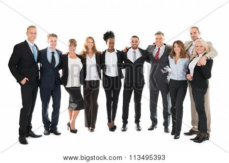 Confident Business Team Standing With Arms Around