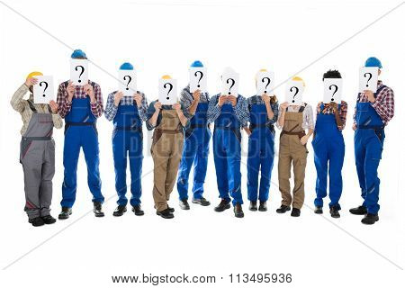 Construction Workers Hiding Faces With Question Mark Signs