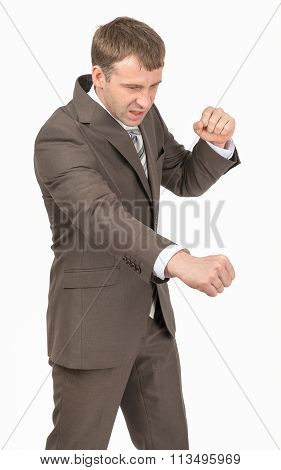 Angry businessman as succesful fighter