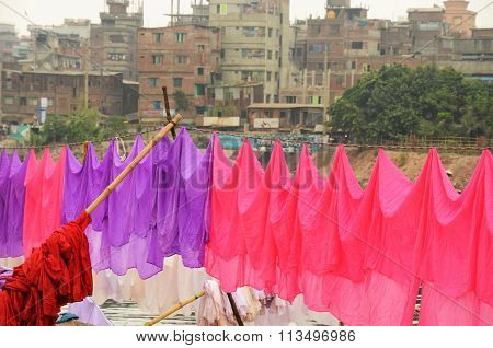 Colorful washing is hanging at the river in Dhaka