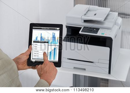 Businessman Giving Print Command On Digital Tablet