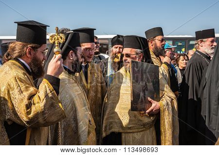 THE BORDER WITH JORDAN, ISRAEL - JANUARY 18, 2008: The festive liturgy Orthodox priests involved.  The Day of the Christian feast of Baptism of Christ in Jordan River