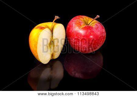 Apples On Black Wavy Mirror.