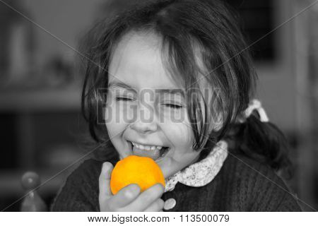 Young girl licking a lemon in selective colour