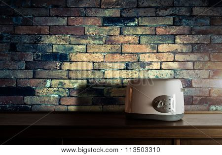 Toaster On Wooden Cupboard In Kitchen Room