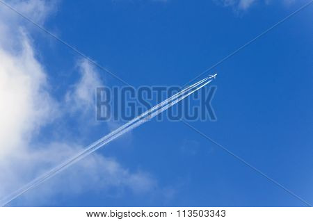 Jet plane leaving trails behind