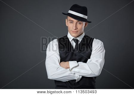 Young Male Confident Male Posing In Gangster Style Suite.