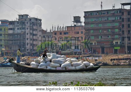 Loaded boat on a river in Dhaka