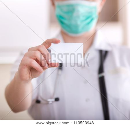 Female Doctor Showing Blank Business Card