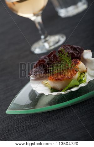 Grilled Scallops In Their Shell On A Black Placemat