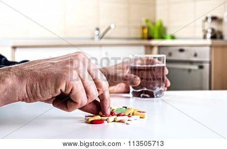 Man Taking Pills
