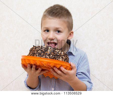Little Boy Licking A Cake