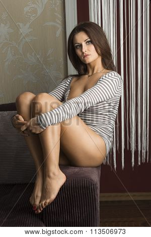 Sensual Girl ,sitting Down On Sofa ,