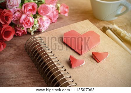 Cup Of Coffee With Flower And Red Heart Shape Paper And Notepad