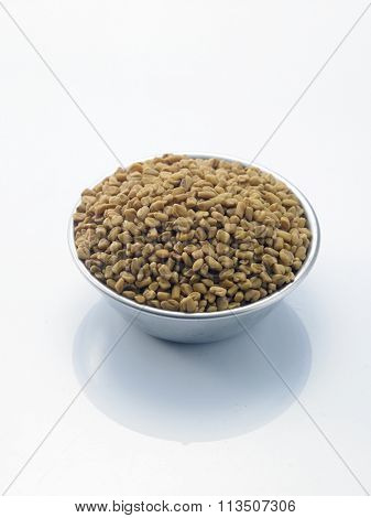 bowl of fenugreek on the white background