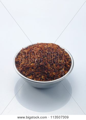 coarse chili powder on the white background