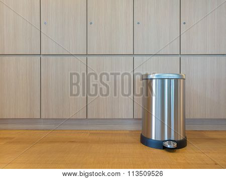 Pedal Bin On Wooden Floor