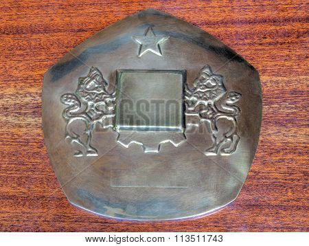 Metal plaque with two lions and a star