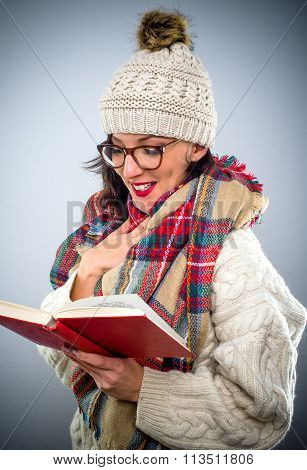 Pretty Young Woman Enjoying Her Book