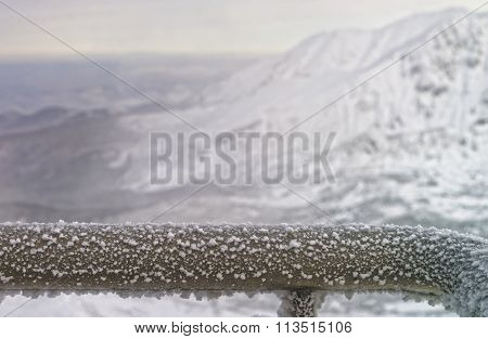 Fragment Of A Fence Rail Being Frozen In Mountains In Winter