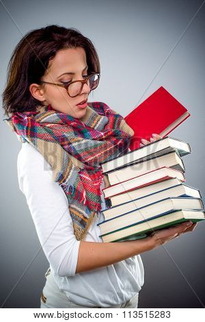 Female Librarian Holding A Pile Of Books