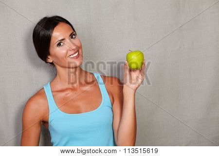 Smiling Young Lady Holding An Apple