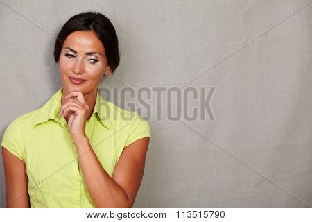 Contemplative Adult Woman With Hand On Chin