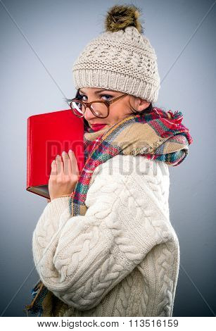 Young Woman Reading A Book In Winter
