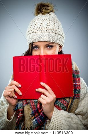 Coy Young Woman Reading A Red Book