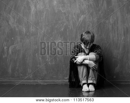 Domestic Violence- Hopeless Woman Is Sitting Against The Wall