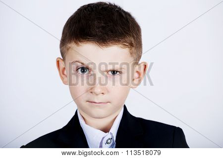 Funny emotion of little boy young man with a raised eyebrow wearing costume with braces.Happy little