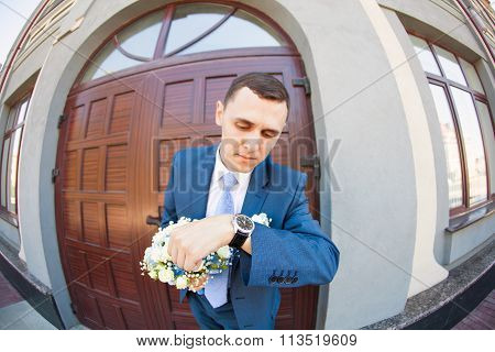 Groom waiting bride.Just married. Close up. Bridal wedding bouquet of flowers
