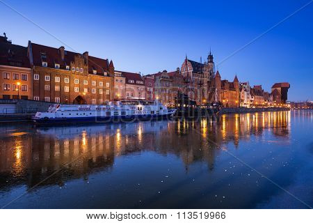 GDANSK, POLAND - JANUARY 3, 2016: Old town of Gdansk at frozen Motlawa river, Poland. Gdansk is the historical capital of Polish Pomerania with medieval old town architecture.