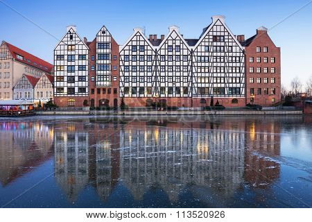 Architecture of the old town in Gdansk with frozen Motlawa river, Poland