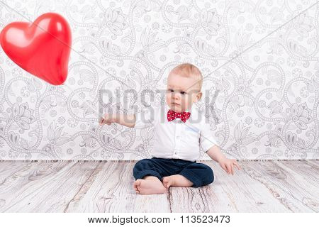 Baby Playing With Red Balloon