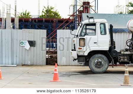 Cement Mixer Truck At A Construction Site, Selective Focus At The Truck