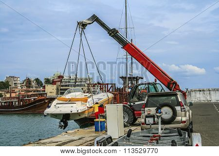 Crane lifts a boat