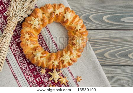 Christmas bread (kalach), traditional Christmas dish in Ukraine over wooden background